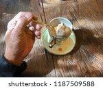 human hand with coffee shake... | Shutterstock . vector #1187509588