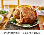 thanksgiving turkey on dinner... | Shutterstock . vector #1187541028