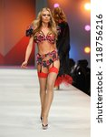 Small photo of Abbey Clancy on the Agent Provocateur catwalk at the Lingerie London show at Old Bilinsgate Market, London 24/10/2012 Picture by: Steve Vas