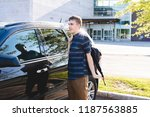 teenager standing beside his... | Shutterstock . vector #1187563885