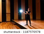 young actor in a theater. | Shutterstock . vector #1187570578