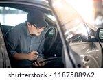 asian auto mechanic sitting on... | Shutterstock . vector #1187588962