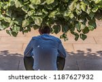 man sitting in the shade of a... | Shutterstock . vector #1187627932