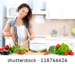 young woman cooking. healthy... | Shutterstock . vector #118766626