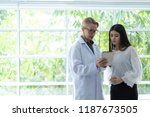 senior female doctors explain... | Shutterstock . vector #1187673505