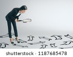 young businesswoman using... | Shutterstock . vector #1187685478