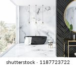 Stock photo white marble and black wood bathroom interior with a black bathtub a round mirror above a black 1187723722
