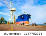 cargo ship moored and mooring... | Shutterstock . vector #1187752315