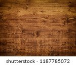 a dark brown wooden background | Shutterstock . vector #1187785072