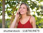 young blonde girl keeping a... | Shutterstock . vector #1187819875
