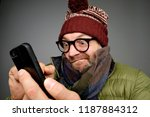 funny man in glasses anf warm... | Shutterstock . vector #1187884312