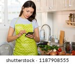 young girl housewife in apron... | Shutterstock . vector #1187908555