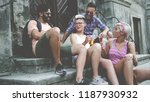 friends sitting on the stairs... | Shutterstock . vector #1187930932