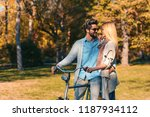portrait of happy young couple... | Shutterstock . vector #1187934112