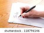person filling out a to do list | Shutterstock . vector #118796146