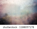 rain drops on glass with city... | Shutterstock . vector #1188057178