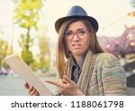 young hipster woman in hat and... | Shutterstock . vector #1188061798