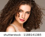 beautiful long curly woman... | Shutterstock . vector #1188141385
