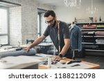 fashion designer working in his ... | Shutterstock . vector #1188212098