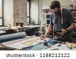 fashion designer working in his ...   Shutterstock . vector #1188212122