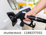 man hand with petrol pump... | Shutterstock . vector #1188257032