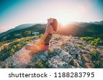 a girl is sitting on top of a... | Shutterstock . vector #1188283795