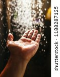 a man's hand in a spray of... | Shutterstock . vector #1188287125
