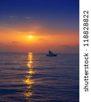 Fisherboat In Horizon On Sunse...