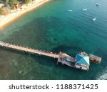 Aerial photography of Kampung Paya Beach and its jetty in Tioman Island. Tioman Island is in Pahang state, Malaysia. It