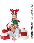 Happy people with christmas hats among presents - isolated - stock photo