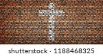 cross painted on brick wall... | Shutterstock . vector #1188468325