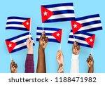 hands waving flags of cuba | Shutterstock . vector #1188471982