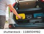hands load bags in car trunk.... | Shutterstock . vector #1188504982
