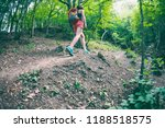 the girl is walking through the ... | Shutterstock . vector #1188518575