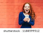 happy woman with mouth wide... | Shutterstock . vector #1188599512