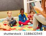 group of children listen... | Shutterstock . vector #1188632545