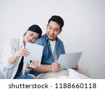 happy asian couple lover using... | Shutterstock . vector #1188660118