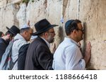 Small photo of Jerusalem, Israel, Aug 19th, 2018: Othodox jewish men wailing at Western Wall, Wailing Wall, an ancient limestone wall in the Old City of Jerusalem, part of the expansion of the Second Jewish Temple