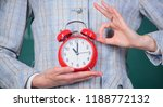 alarm clock in female hands...   Shutterstock . vector #1188772132