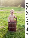 A Small Child Bathes In A...