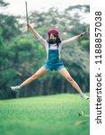 a beautiful woman posing jump... | Shutterstock . vector #1188857038