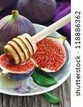 Fresh ripe figs and sweet honey. - stock photo