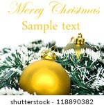 Christmas ornaments in snow - stock photo