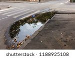 damaged road  cracked asphalt... | Shutterstock . vector #1188925108