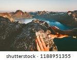 man hands climbing up to... | Shutterstock . vector #1188951355