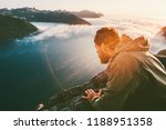 man on the edge cliff above sea ... | Shutterstock . vector #1188951358
