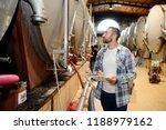 handsome man winemaker in a... | Shutterstock . vector #1188979162