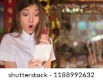 smiling excited asian woman... | Shutterstock . vector #1188992632