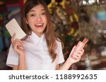 smiling excited asian woman... | Shutterstock . vector #1188992635