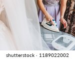 woman ironing delicate fabric   Shutterstock . vector #1189022002